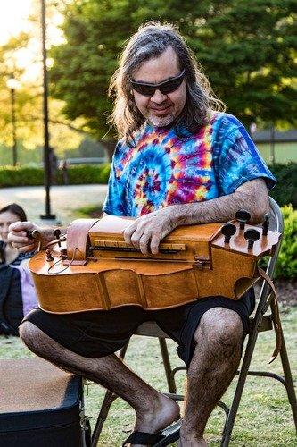 man playing herdy gurdy