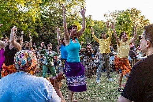 people dancing in the drum circle