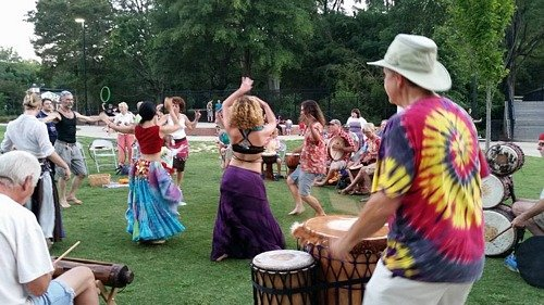 belly dancers and dancers in the drum circle