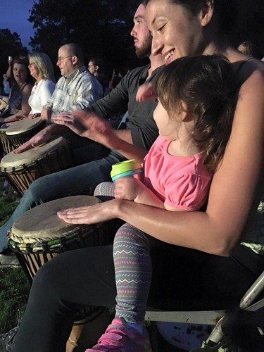family playing in the drum circle