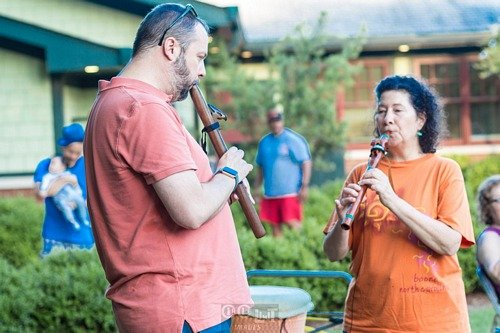 people playing native american flutes