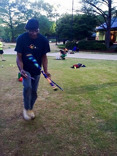 man using juggling sticks