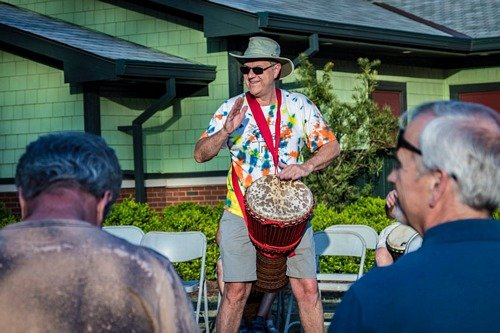 Tony leading the Raleigh drum circle playing djembe