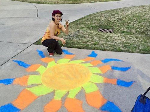 chalk artist with her artwork