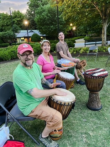 happy people playing djembes and krin